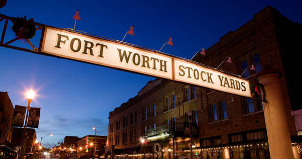 Stockyards Photograph - Signboard Over A Road At Dusk, Fort by Panoramic Images