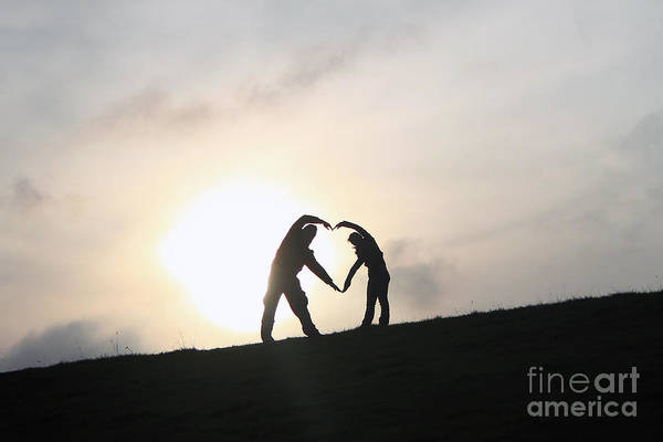 Silhouette Couple Forming A Heart Art Print