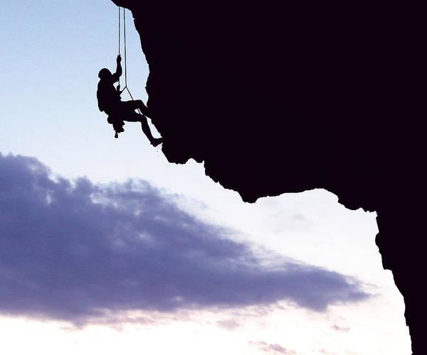 Silhouette Photograph - Silhouette Man Climbing Mountain by Stijn Dijkstra / Eyeem