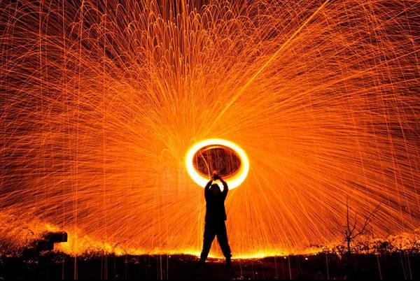 Silhouette Photograph - Silhouette Man Spinning Illuminated by Phil Ingham / Eyeem