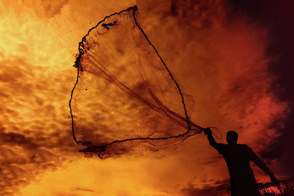 Silhouette Photograph - Silhouette Of A Man Throwing Fishing Net by Www.imagesbyhafiz.com