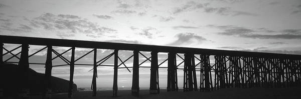 Fort Bragg Photograph - Silhouette Of A Railway Bridge, Fort by Panoramic Images