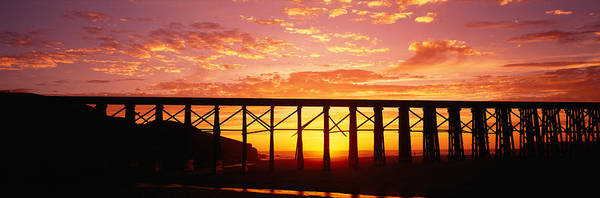 Fort Bragg Wall Art - Photograph - Silhouette Of A Railway Bridge, Pudding by Panoramic Images