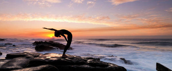 Yoga Photograph - Silhouette Of A Woman Practicing Yoga by Panoramic Images