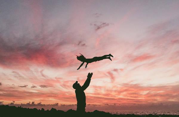 La Gomera Wall Art - Photograph - Silhouette Of Man Throwing Son by Sergio Villalba
