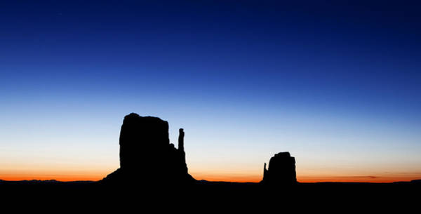 Navajo Indian Reservation Photograph - Silhouette Of The Mitten Buttes In Monument Valley  by Susan Schmitz