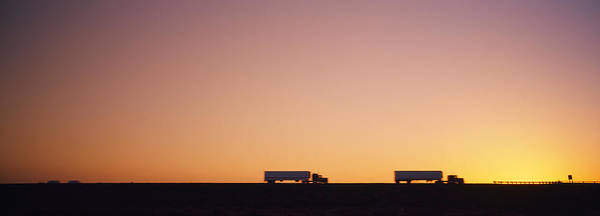 Interstate 5 Wall Art - Photograph - Silhouette Of Two Trucks Moving by Panoramic Images