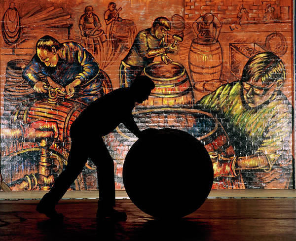 Wall Art - Photograph - Silhouette Of Whisky Worker Rolling Whisky Cask by Jesse/science Photo Library