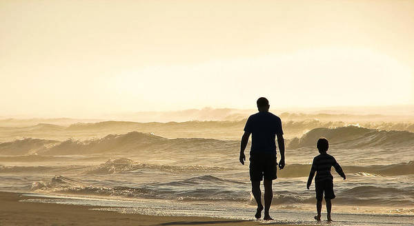 Photograph - Silhouetted Father And Son Walk Beach  by Jo Ann Tomaselli