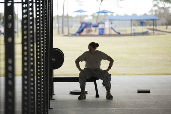 Silhouetted Female Soldier Barbell Training At Air Force Military Base Art Print by Sean Murphy