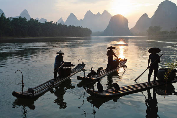 Chinese Clothing Wall Art - Photograph - Silhouettes Of Fishermen On Li River by Thomas Kokta