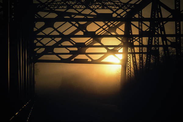 Wall Art - Photograph - Silhouettes Of Girders Of Bridge At Dusk by Ron Koeberer