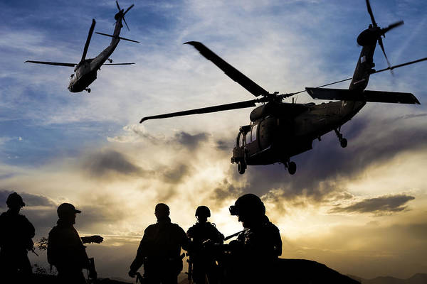 Silhouettes Of Soldiers During Military Mission At Dusk Art Print by Guvendemir