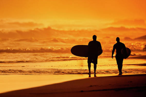 Wall Art - Photograph - Silhouettes Of Surfers On The Beach by Design Pics Vibe