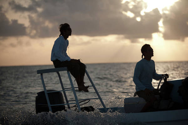 Belize Photograph - Sillouetted Man Steers Flats Boat by Chris Ross