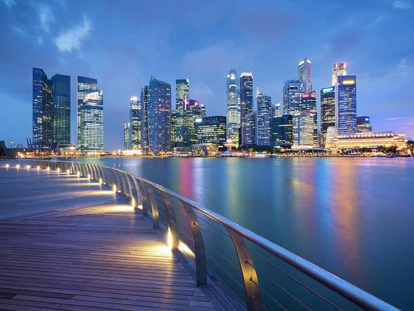 Prosperity Photograph - Singapore Skyline Seen Over Marina Bay by Travelpix Ltd