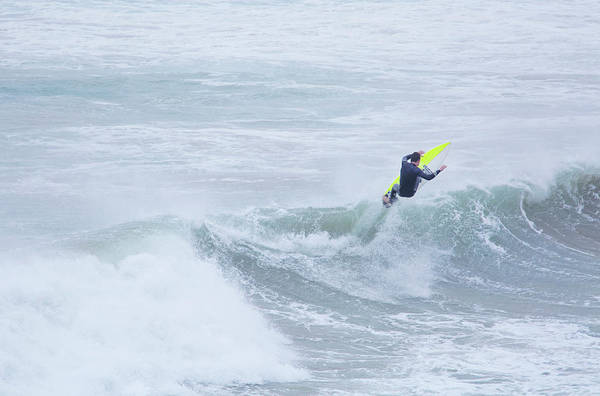 Wetsuit Wall Art - Photograph - Single Surfer Riding A Wave In Autumn by James Silverthorne