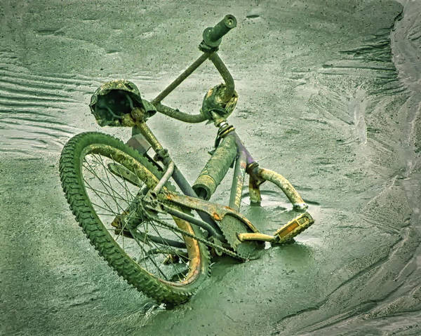 Photograph - Sinking Bike In Mud by Gary Slawsky