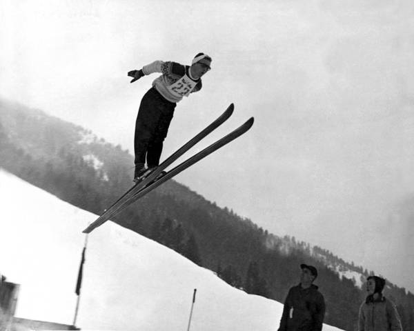 Ski Jumping Photograph - Ski Jumper Takes To The Air by Underwood Archives