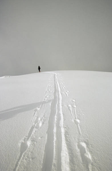 Wall Art - Photograph - Skier And His Track Cresting A Mountain by Woods Wheatcroft