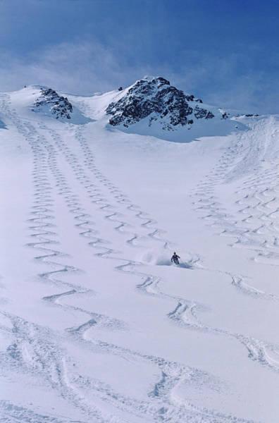 Ski Tracks Wall Art - Photograph - Skier Enjoying The Backcountry by Howie Garber