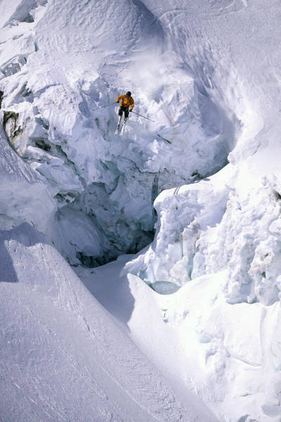 Blue Jackets Photograph - Skier Is Jumping Off A Huge Serac by Patrik Lindqvist