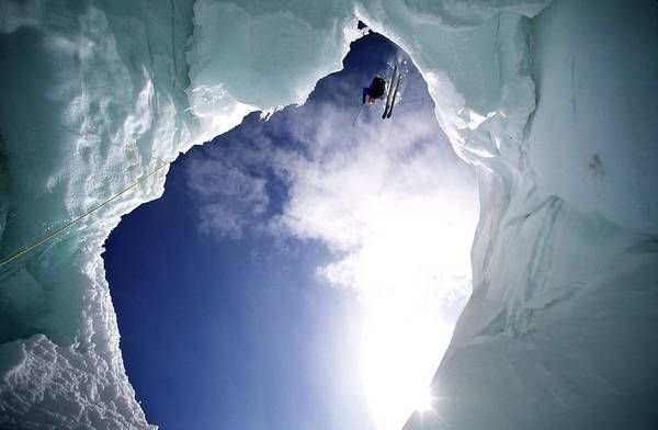 Blue Jackets Photograph - Skier Is Jumping Over A Glacier Cave by Patrik Lindqvist