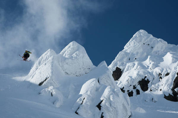 Wall Art - Photograph - Skier Jumping Off A Cliff by Adam Clark