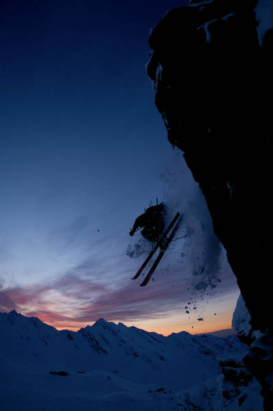 Ski Jumping Photograph - Skier Jumping Off  A Cliff At Sunset by Adam Clark
