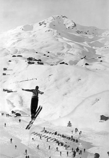Ski Jumping Photograph - Skier Leaping Over A Valley by Underwood Archives