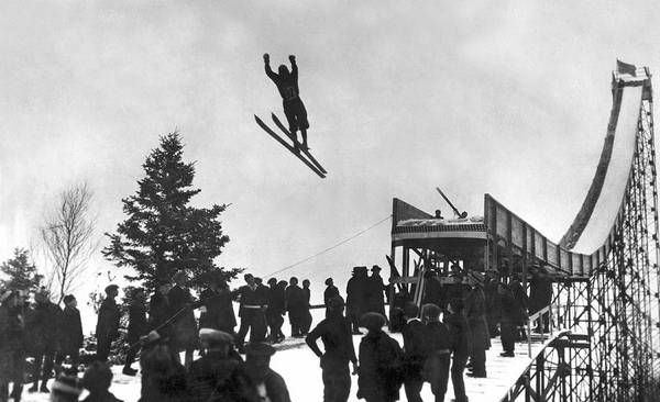 Exertion Wall Art - Photograph - Skier Off A Jump by Underwood Archives