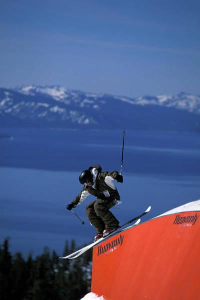 Ski Tracks Wall Art - Photograph - Skier On A Rail In A Terrain Park by Corey Rich
