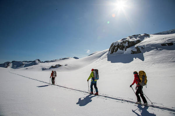Ski Tracks Wall Art - Photograph - Skiers Ascend A Skin Track At The Top by Michael Hanson