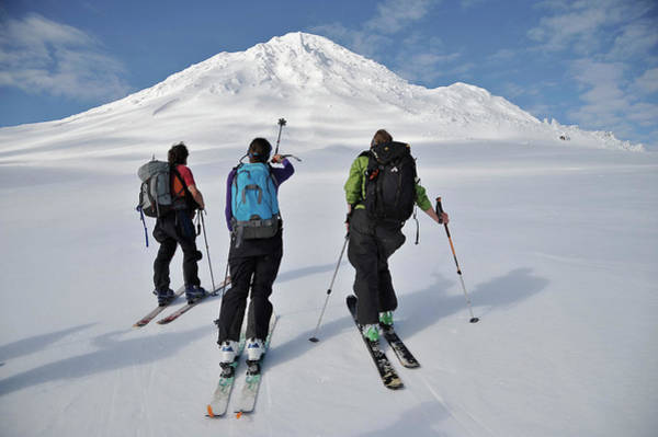 Gulf Of Alaska Photograph - Skiers Ascend The Northeast Flanks Of by HagePhoto