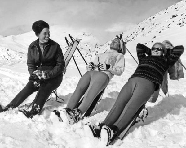 Parks And Recreation Photograph - Skiers Basking In The Sun by Underwood Archives