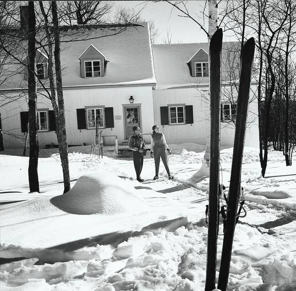 Snow Photograph - Skiers By A Ski Resort Cottage by Toni Frissell