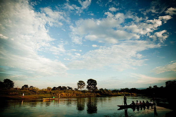 Wall Art - Photograph - Sky And River Wuth Boat by Raimond Klavins