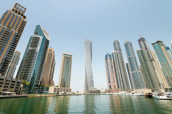 Luxury Yacht Photograph - Skyline Of New Skyscrapers At Dubai by Iain Masterton