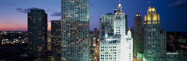 Chicago Tribune Wall Art - Photograph - Skyscraper Lit Up At Night In A City by Panoramic Images