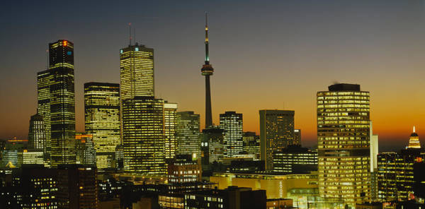 Cn Tower Photograph - Skyscrapers Lit Up At Dusk, Toronto by Panoramic Images