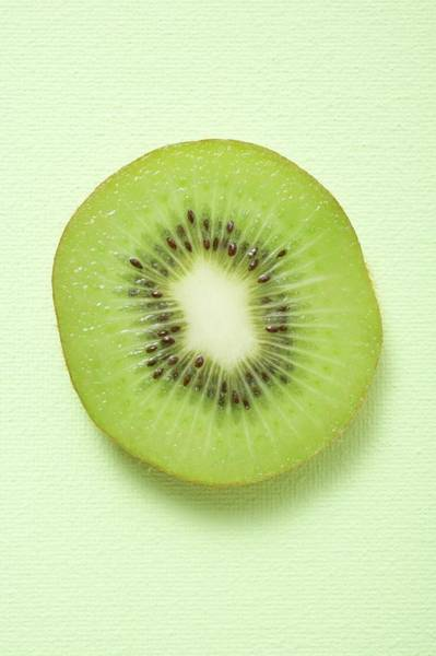 Kiwifruit Photograph - Slice Of Kiwi Fruit (overhead View) by Foodcollection