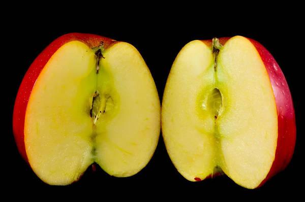 Photograph - Sliced Apples On Black Background by Alex Grichenko