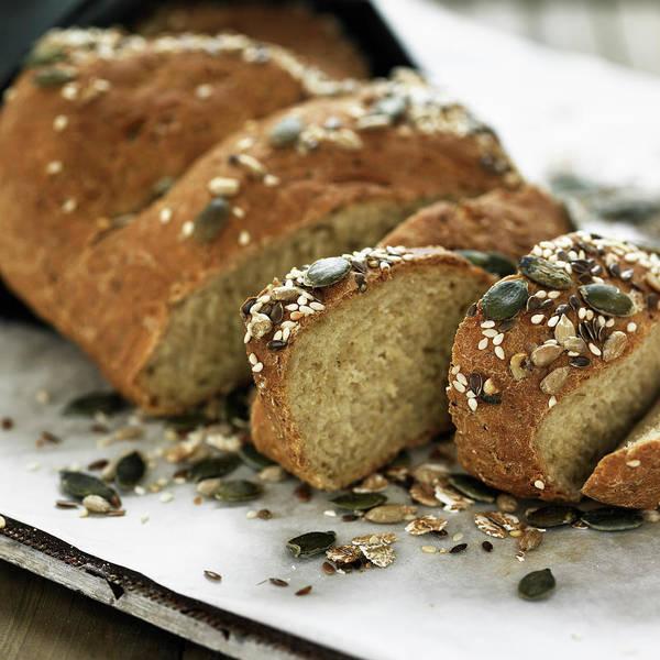 Sunflower Seeds Photograph - Sliced Whole Grain Bread On Board by Lisbeth Hjort
