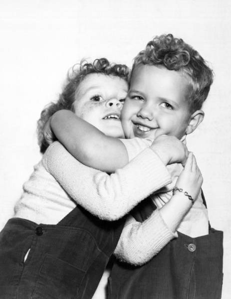 Cuddle Photograph - Small Boy Hugging His Sister by Ed Estabrook