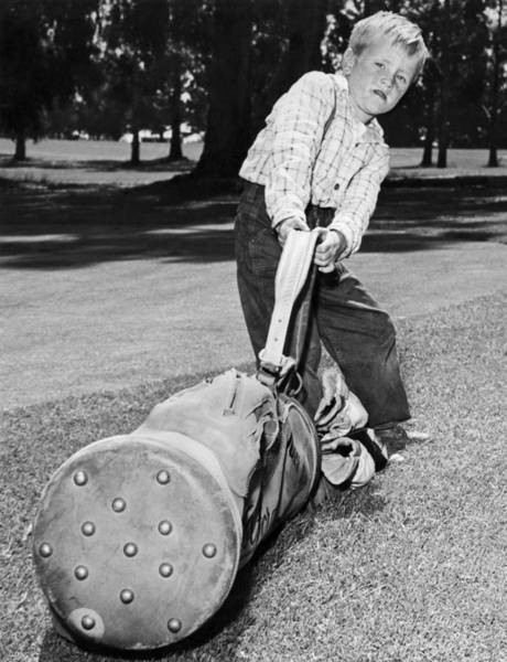 Determination Photograph - Small Boy Totes Heavy Golf Bag by Underwood Archives