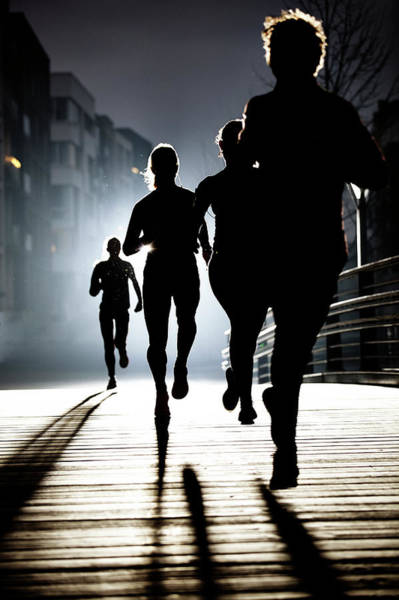 Real People Photograph - Small Group Of Runners By Night by Henrik Sorensen