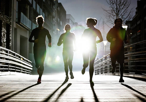 Candid Photograph - Small Group Of Runners by Henrik Sorensen