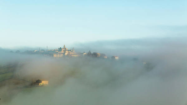 Photograph - Small Italian Village In The Fog by Deimagine
