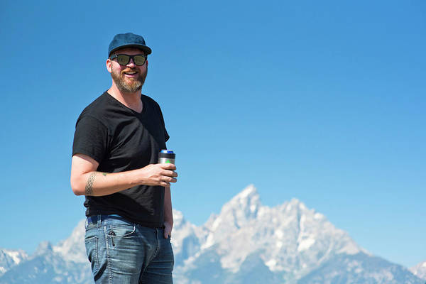 Wall Art - Photograph - Smiling Man Holding Beer With Teton by Rob Hammer