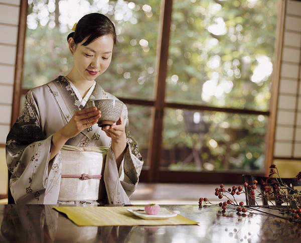 Smiling Woman Drinking Tea During A Japanese Tea Ceremony Art Print by Digital Vision.